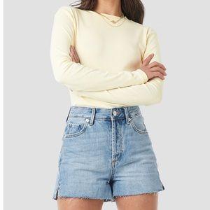 Light denim shorts. Never worn.
